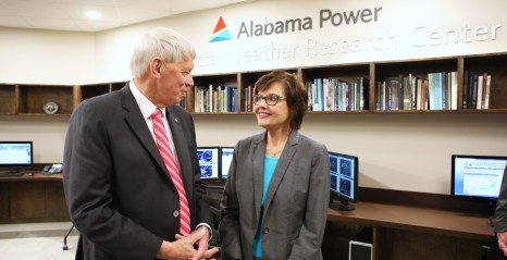 Dr. Tony Waldrop, University of South Alabama president, talks with Beth Thomas, corporate communications manager for Alabama Power, inside the new Alabama Power USA Coastal Weather Research Center. The center provides weather forecasting to more than 100 clients. (Mike Kittrell)