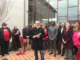 Firehouse board president Donald Lupo speaks at the ribbon cutting for the organization's new $5.8 million homeless shelter. (Erica Wright/The Birmingham Times)