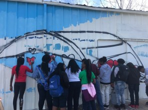 STEAM Academy students work on a portion of their mural depicting the Edmund Pettus Bridge. (Michael Jordan/Alabama NewsCenter)