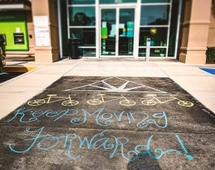 Regions Bank branches decorated sidewalks and pavement with chalk messages to remind walk-up ATM customers about social distancing requirements. (Doing More Today)