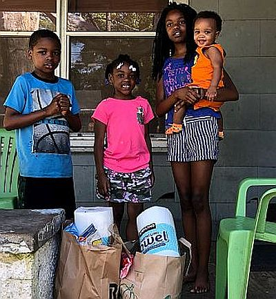 Extra groceries are helping families in Prichard during the COVID-19 crisis. (John Eads/Light of the Village)