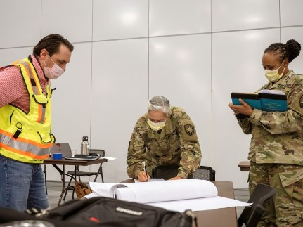 Representatives of Robins & Morton and the Army Corps of Engineers hold a planning meeting at the project command center away from the construction site, which is why the participants are not wearing hard hats. (contributed)