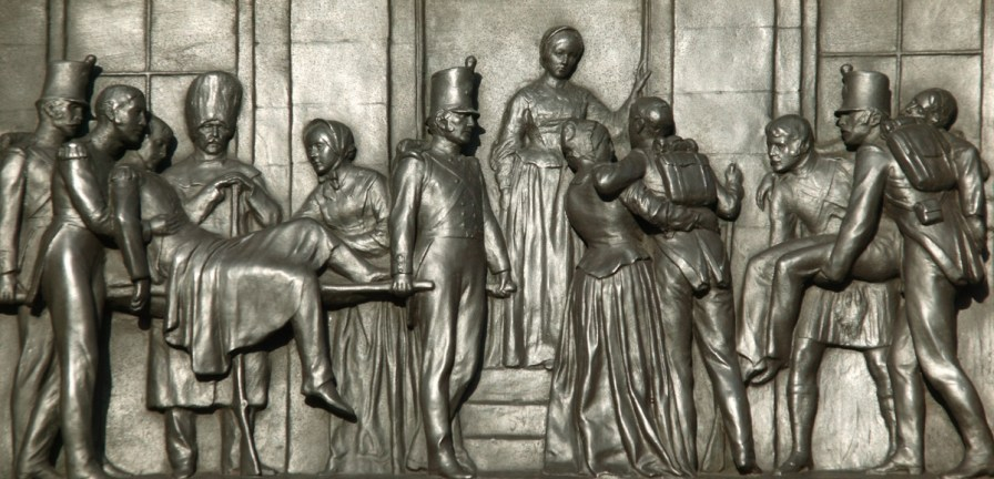 """A Victorian plaque in London depicts Florence Nightingale, an English nurse known as """"the lady with the lamp,"""" assisting wounded soldiers in the Crimean War. (Getty Images)"""