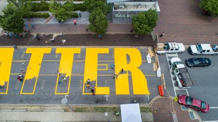 The BLACK LIVES MATTER street painting came together in less than two days in front of Birmingham Railroad Park. (Jay Parker / Alabama NewsCenter)