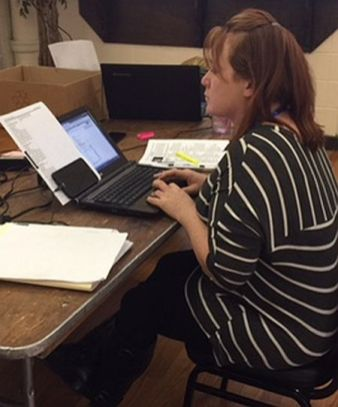 A participant learns to work in a call center. (Dannon Project)