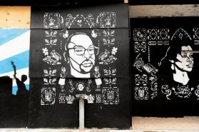 Artists in Birmingham turned plywood covering broken windows from a night of violent protests into art promoting peace and unity. (Phil Free / Alabama NewsCenter)