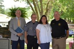 Lee County Sheriff Jay Jones, Tallapoosa County Sheriff Jimmy Abbett, Girls Ranch Director Candice Gulley and Chambers County Sheriff Sid Lockhart pose at the farm. (contributed)