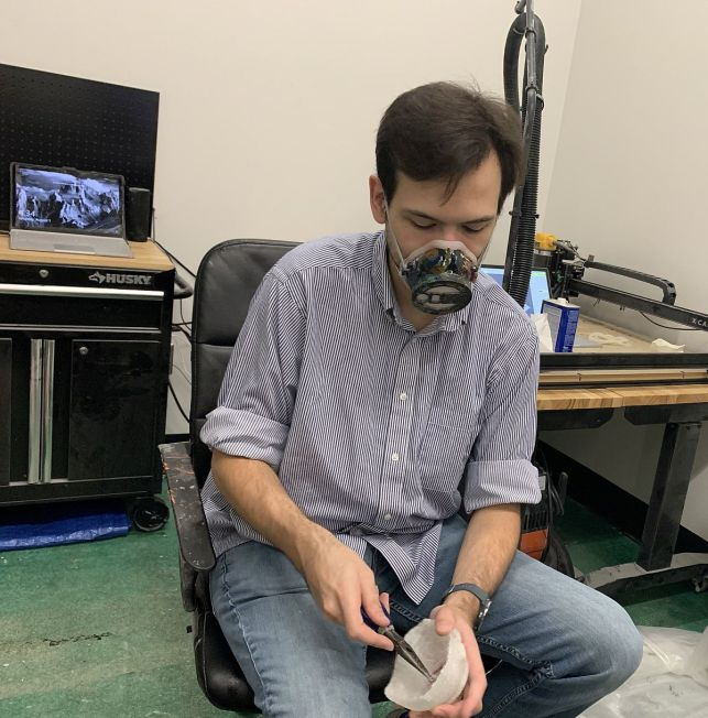 Trimming the inside of the mask. (Donna Cope/Alabama NewsCenter)