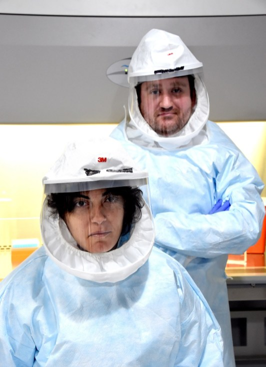 Research scientists Rebecca Boohaker and Justin Avery in a Biological Safety Level-3 containment training facility at Southern Research. (Mark Almond/The Birmingham Times)