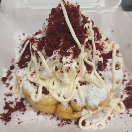 Funnel Cake Queen's 32 variations on the popular treat can be topped with ice cream, fresh fruit, bits of candy or cereal, syrup and whipped cream. (Funnel Cake Queen)