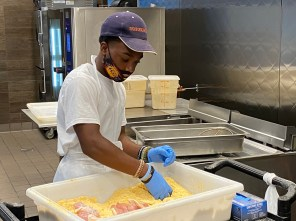 Donald Dees works in the kitchen as part of the Pannie-George's Leadership Academy. (Michael Jordan / Alabama NewsCenter)