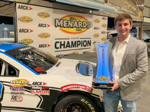 Bret Holmes poses with the 2020 ARCA Menards Series championship trophy after Tuesday's night ceremony at Talladega Superspeedway. (contributed)