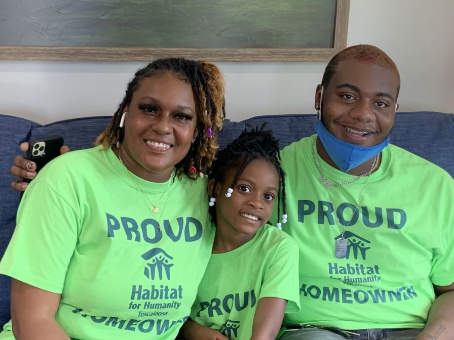 "Carletta, Eternity and Anthony ""A.J."" Wooley are thrilled with their new home. (Donna Cope / Alabama NewsCenter)"