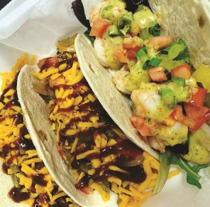 Tacos made with brisket, left, and shrimp. (Bigbee Coffee Roasters)