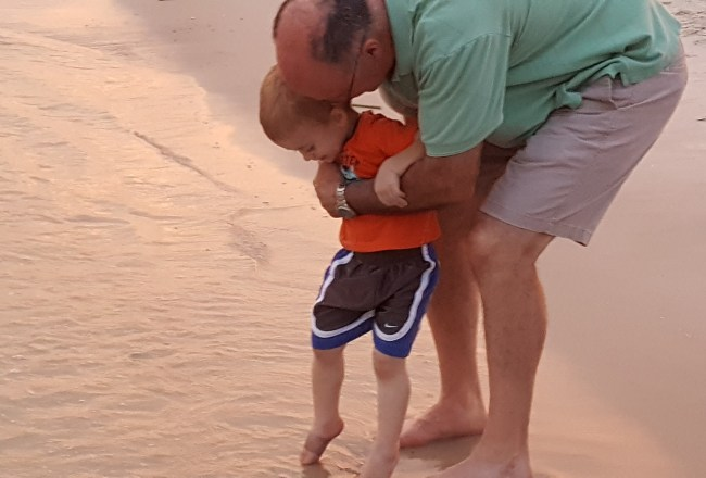 alavhr grandpa with boy at beach