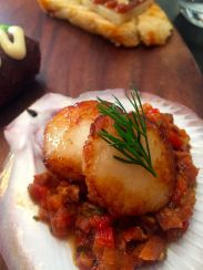 Pan seared local scallop with sautéed chorizo, roasted capsicum, tomato and green onion