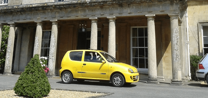 What's wrong with having a photobombing yellow car?