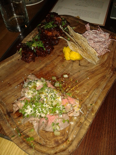 Heddon Street Kitchen meat starters of tamarind spiced chicken wings, roasted veal carpaccio and potted salt beef brisket