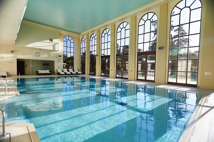 swimming pool at Stoke Park luxury hotel
