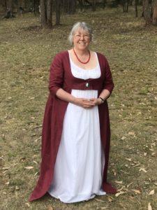 Crimson print open robe over white muslin gown