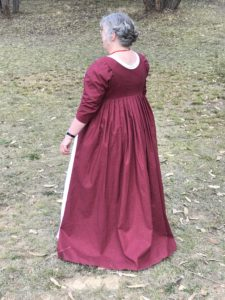 Back view of crimson printed open robe