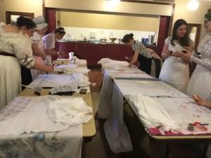 People blockprinting muslin shawls
