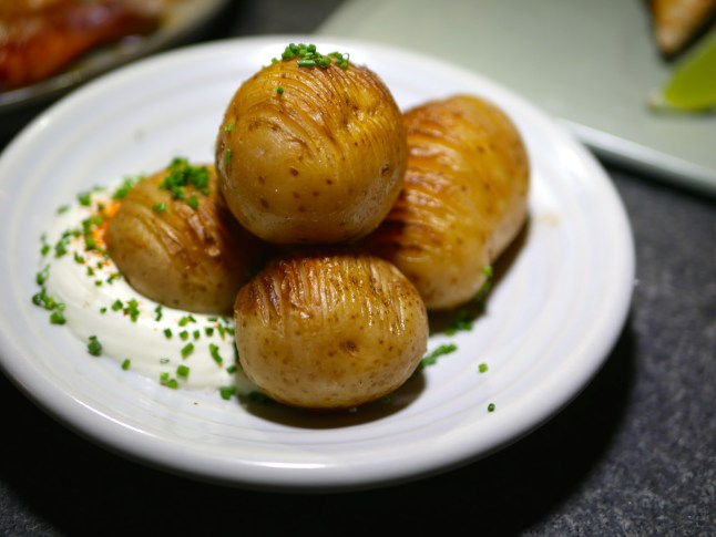 Sides - Hasselback Potato served with Sour Cream and Chives ($9)