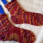 Socks created out of the Celtic Sunset colorway, using the Nutkin pattern on Ravelry: http://www.ravelry.com/patterns/library/nutkin