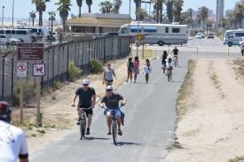 Cyclists on Huntington Beach Bike Trail on Memorial Day weekend 2015.