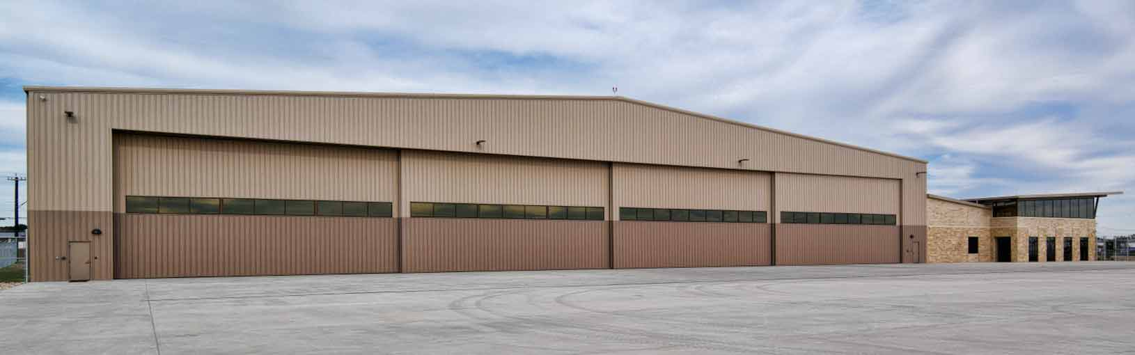 Four Hangar Doors on Zachry Building