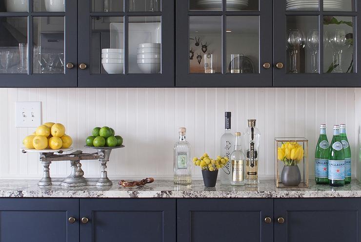 navy-kitchen-cabinets-white-gray-granite-countertops-beadboard-backsplash