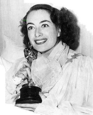 photo of Joan Crawford clutching Oscar statuette in 1945