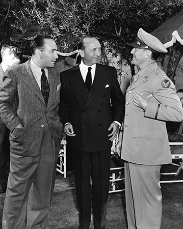Jack Warner, Michael Curtiz, Hal Wallace during the filming of Casablanca