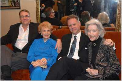 photo of Alan K. Rode with Joan Leslie, Eddie Muller, and Marsha Hunt all seated together on lobby sofa