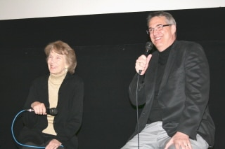 photo of Julia Adams seated on stage with Alan K. Rode