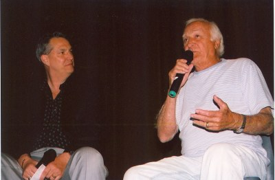 photo of Robert Loggia and Alan K. Rode seated side by side on stage