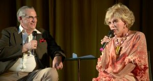photo of Ruta Lee and Alan K. Rode on stage for interview