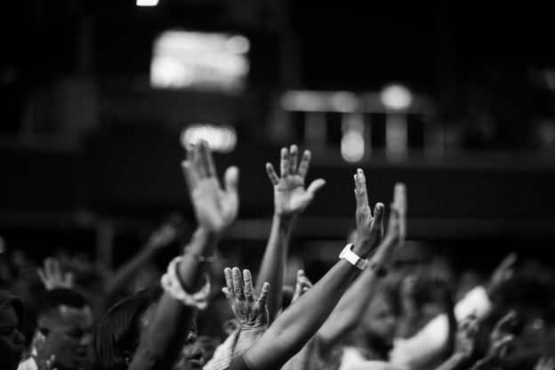 People with their hands raised