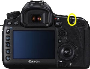 This is the AF On button on the Canon 5D sr. This button can be made to trigger the autofocus (also remember to turn shutter autofocus off )