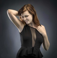 Madison gives a playful tug at the neckline defines alluring.