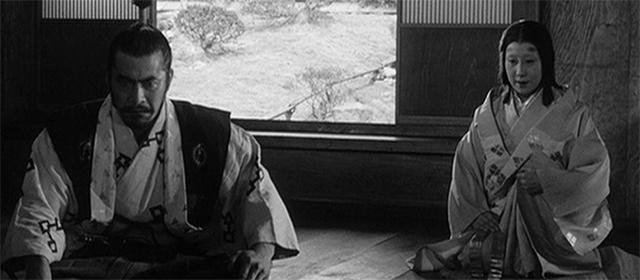 Toshirô Mifune et Isuzu Yamada dans Le Château de l'Araignée (1957)