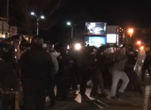 Protesters and police clash in Ferguson.