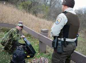 Refuge law enforcement officer Scott Pariseau check hunter licenses, equipment and hunting activity in order to make sure that hunting is conducted safely and following regulations. Photo by Mara Koenig/USFWS.