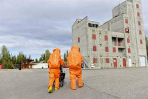 U.S. Air Force Senior Airman Eric McComb and U.S. Army Staff Sgt. Andrew Markham, both Chemical, Biological, Radiological and Nuclear (CBRN) technicians with the 103rd Weapons of Mass Destruction-Civil Support Team (WMD-CST), out of Kulis Air National Guard Base, Alaska, walk toward a building with potential CBRN threats Aug. 23, 2016, at the Fairbanks Regional Fire Training Center in Fairbanks, Image-Airman Isaac Johnson