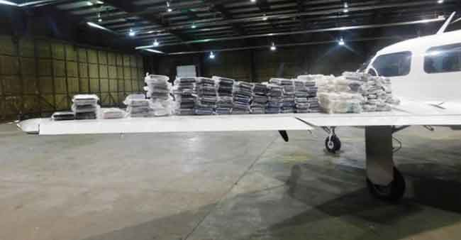 Two Arrested, Nearly 300 Pounds of Cocaine Seized from Canada-Bound Aircraft
