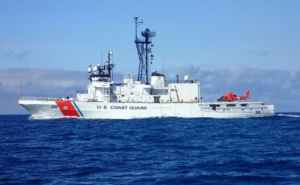 BERING SEA, Alaska - The Coast Guard Cutter Alex Haley is pictured before a Bering Sea patrol with a Coast Guard Air Station Kodiak MH-66 Dolphin helicopter embarked on the stern of the cutter. Image-USCG