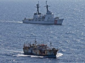 Coast Guard Cutter Rush escorting suspected high seas drift net fishing vessel Da Cheng in the North Pacific Ocean in 2012.
