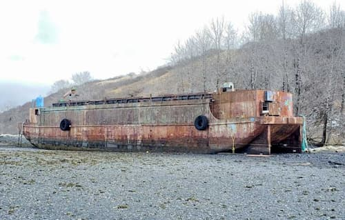 Coast Guard, Contractors Respond to Pollution Threat from Derelict Barge on Kodiak Island