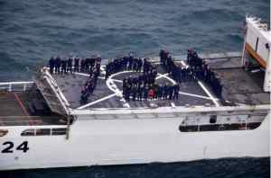 U.S. Coast Guard Cutter Douglas Munro crewmembers stand in formation on the back of the cutter, July 24, 2020. The cutter's hull day, July 24th, correlates with its hull number, 724. U.S. Coast Guard courtesy photo.
