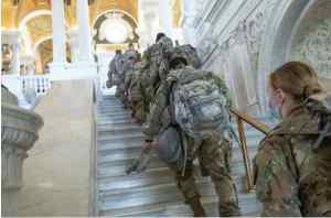 U.S. Airmen and Soldiers with the Alaska National Guard climb the stairs inside the Library of Congress in Washington, D.C., (U.S. Army National Guard photo by Sgt. Mike Risinger)
